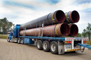Rogers Transport is delivering steel pipes to a large coal seam gas project in Queensland using Freighter semi-trailers.