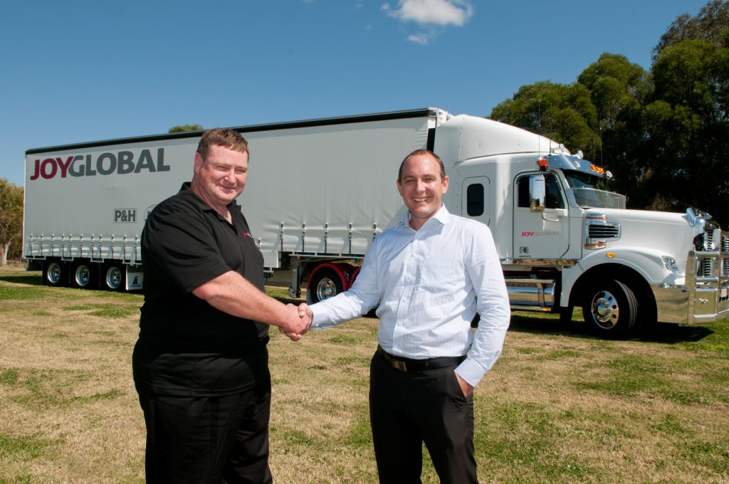 Trailer Sales' Area Sales Manager, Richard Jenson (right), congratulates Torque Logistics Warehouse and Distribution Manager, Daryl Morrison, on the company's new Freighters.